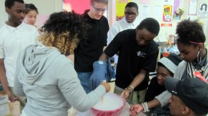 Colin Paul, center, looks on as high schoolers us liquid nitrogen to make ice cream. Photo by Mary Spiro.
