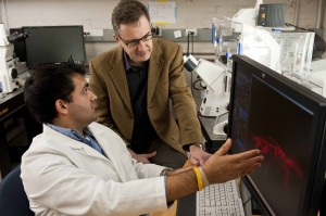 Denis Wirtz, right, working with recent PhD graduate Shyam Khatau. (Photo Will Kirk/Homewood Photography)