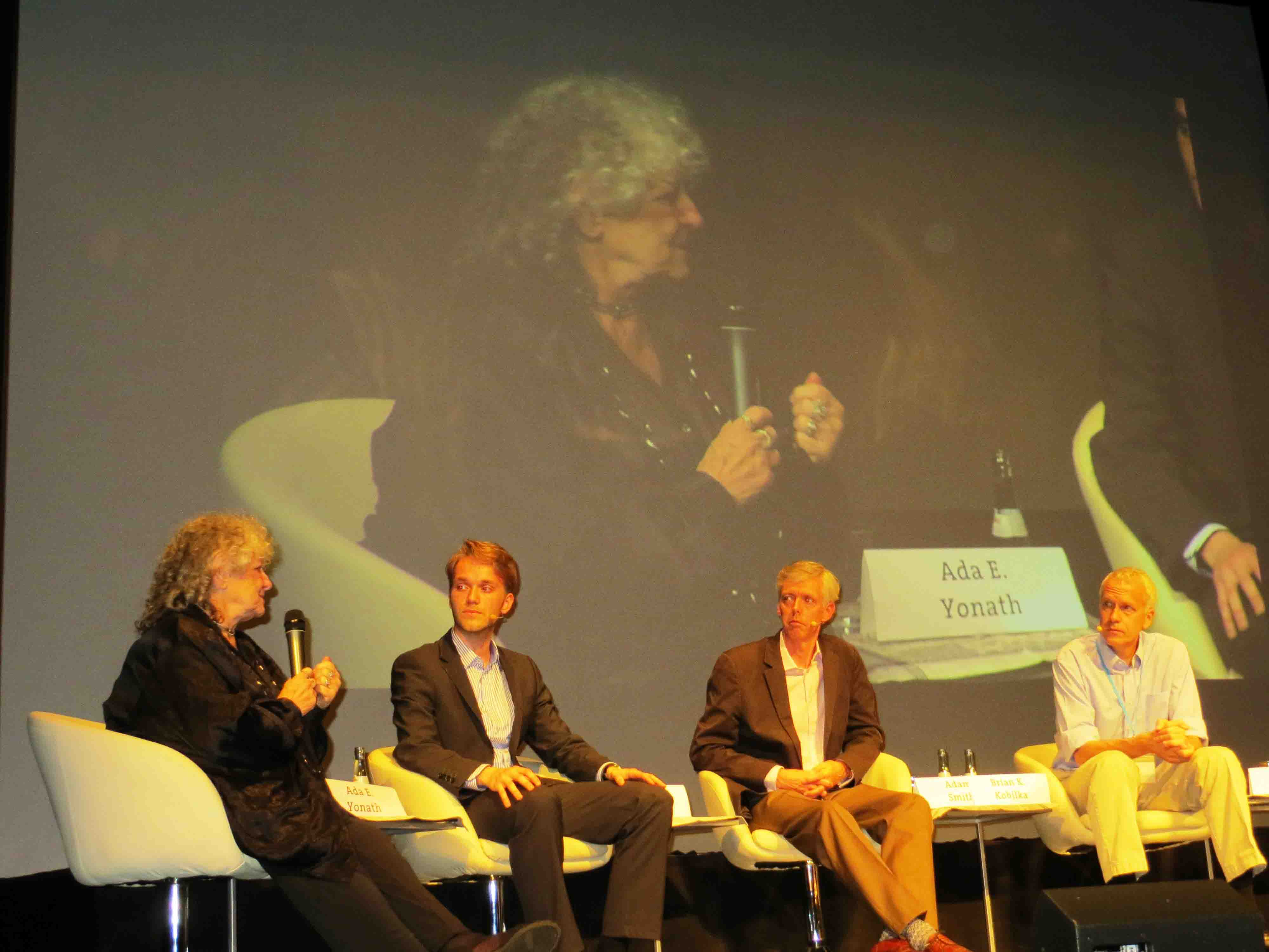 A panel of Nobel Laureates and scientists discusses the importance of communication in science. Speaking in this photo is Ada Yonath (far left), who won the Nobel Prize for Chemistry in 2009 for her studies on the structure and function of the ribosome.
