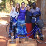 GEU design team with the finalized pedal power grain mill in Tanzania (from left to right) Kristen Kosielski, Jeannine Coburn, Iwen Wu and local resident Jackson. (Photo courtesy Jeannine Coburn)